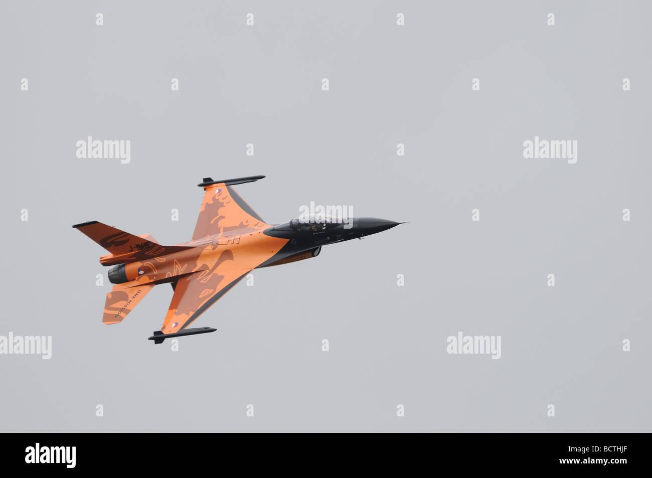 Royal Netherlands Air Force Koninklijke Luchtmacht  F-16 Fighter Jet in distinctive 'one mission' orange - Stock Image