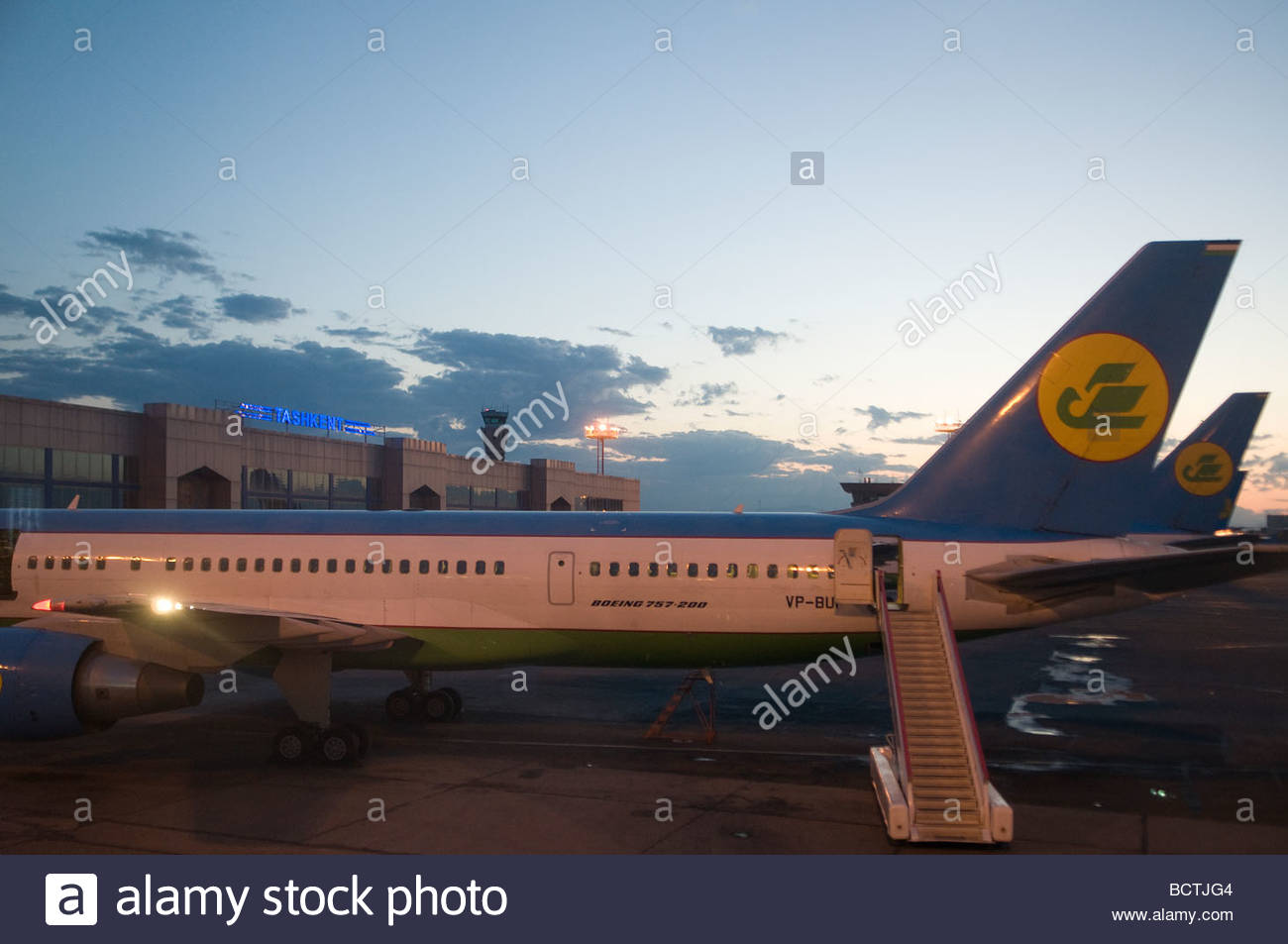 Two airplanes of National Air Company Uzbekistan Airways stand on the tarmac at Tashkent International Airport Uzbekistan - Stock Image