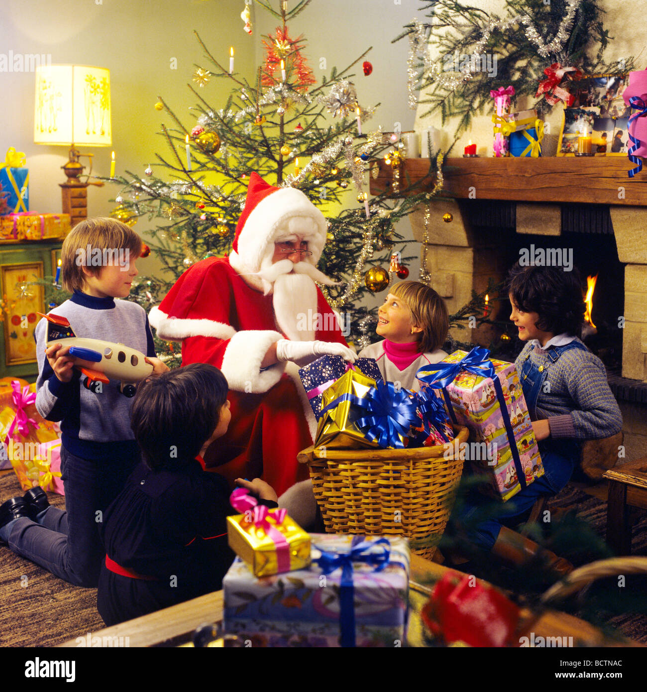 mr santa claus giving christmas presents to 4 children - Santa Claus With Presents
