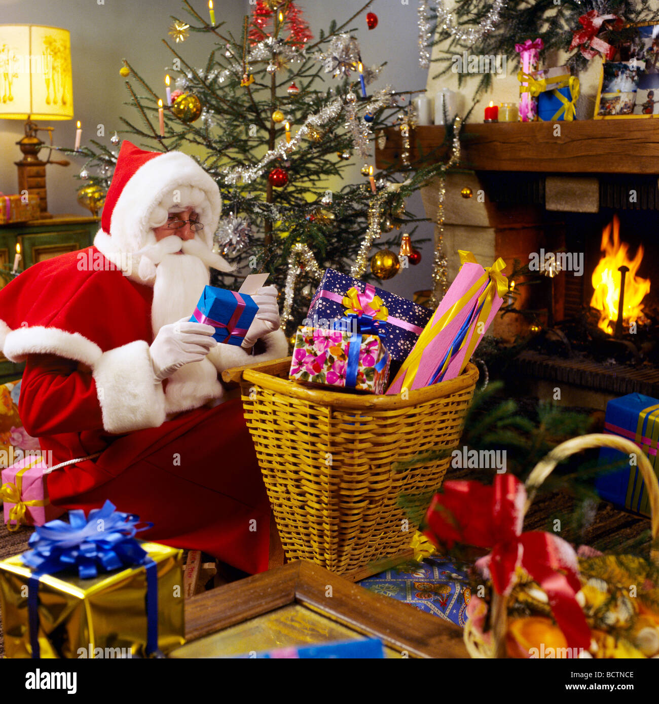 Picture Of Christmas Tree With Presents: MR SANTA CLAUS PREPARING CHRISTMAS PRESENTS UNDER THE TREE