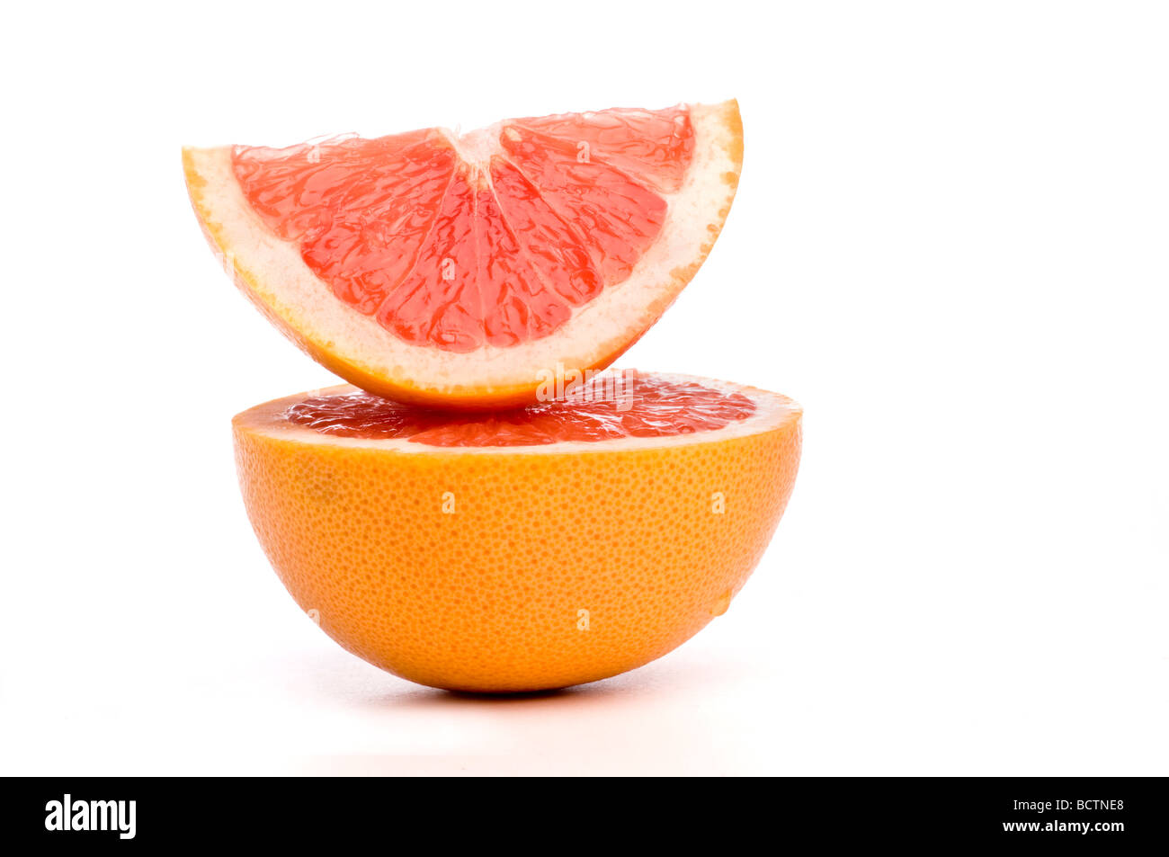 grapefruit slices arranged on top of each other. - Stock Image