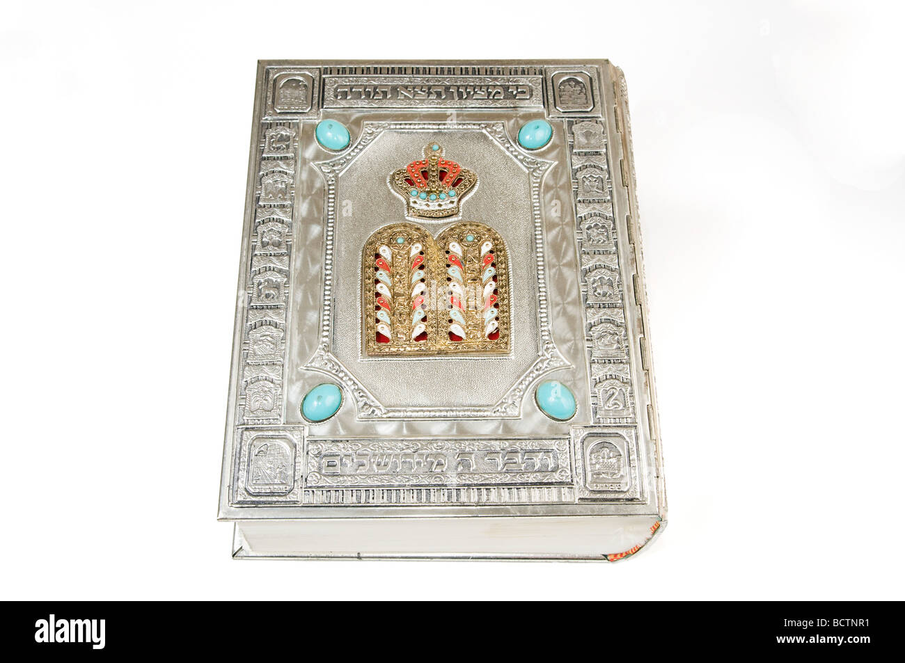 Cutout of a silver bound Holy Bible on white background - Stock Image