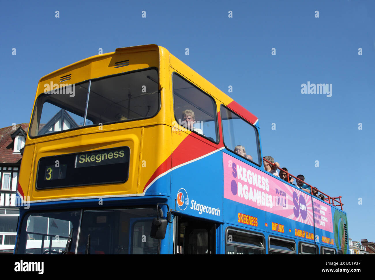 An open top tour bus at Skegness, Lincolnshire, England, U.K. - Stock Image