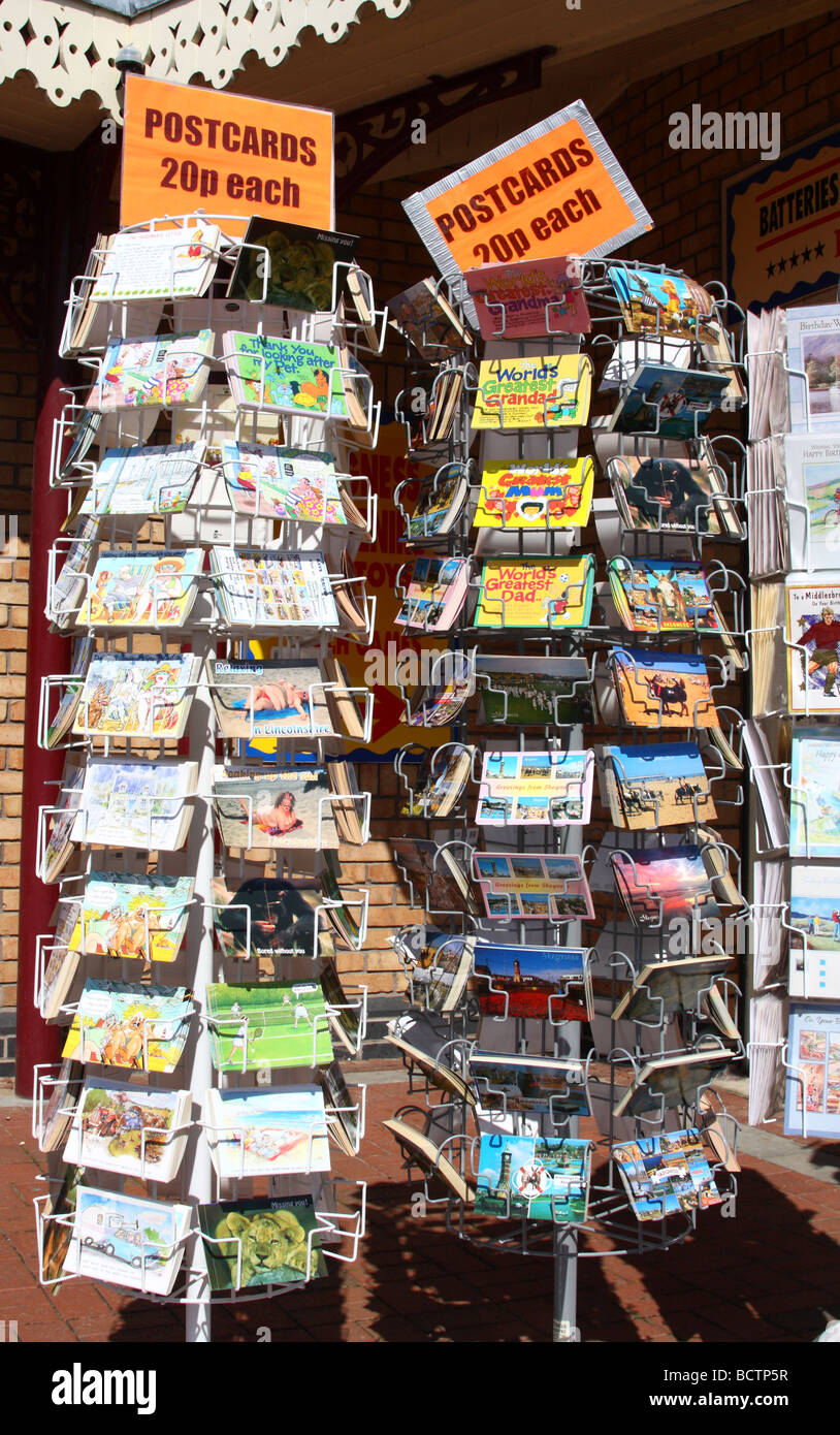 Postcards for sale at an English holiday resort. - Stock Image