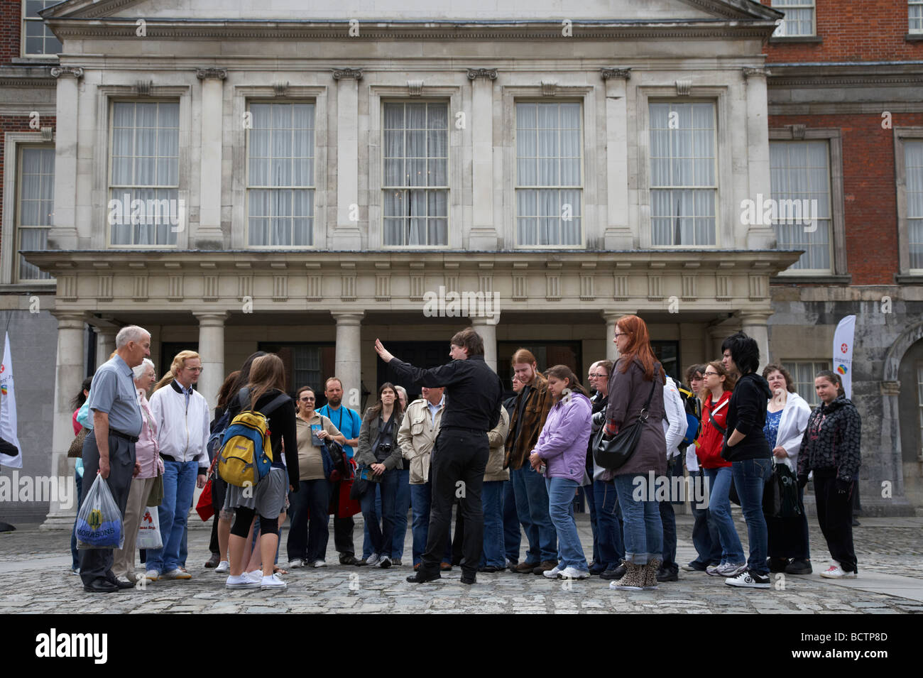 organised tour group of tourists in the the great courtyard upper courtyard in front of the state apartments in - Stock Image