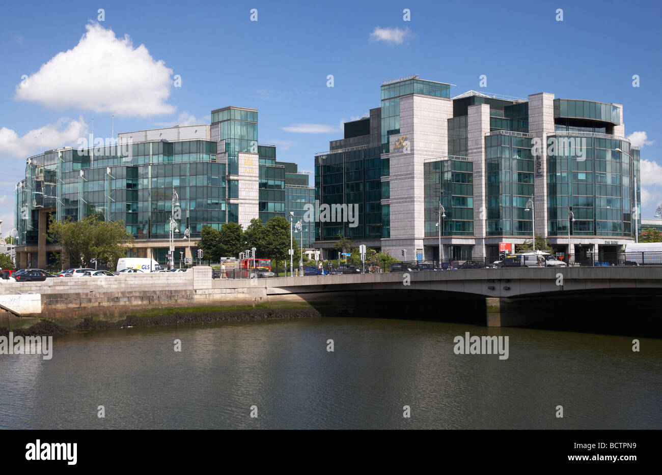 AIB Allied Irish Bank International centre headquarters of AIB Capital Markets and the IFSC on the river liffey - Stock Image
