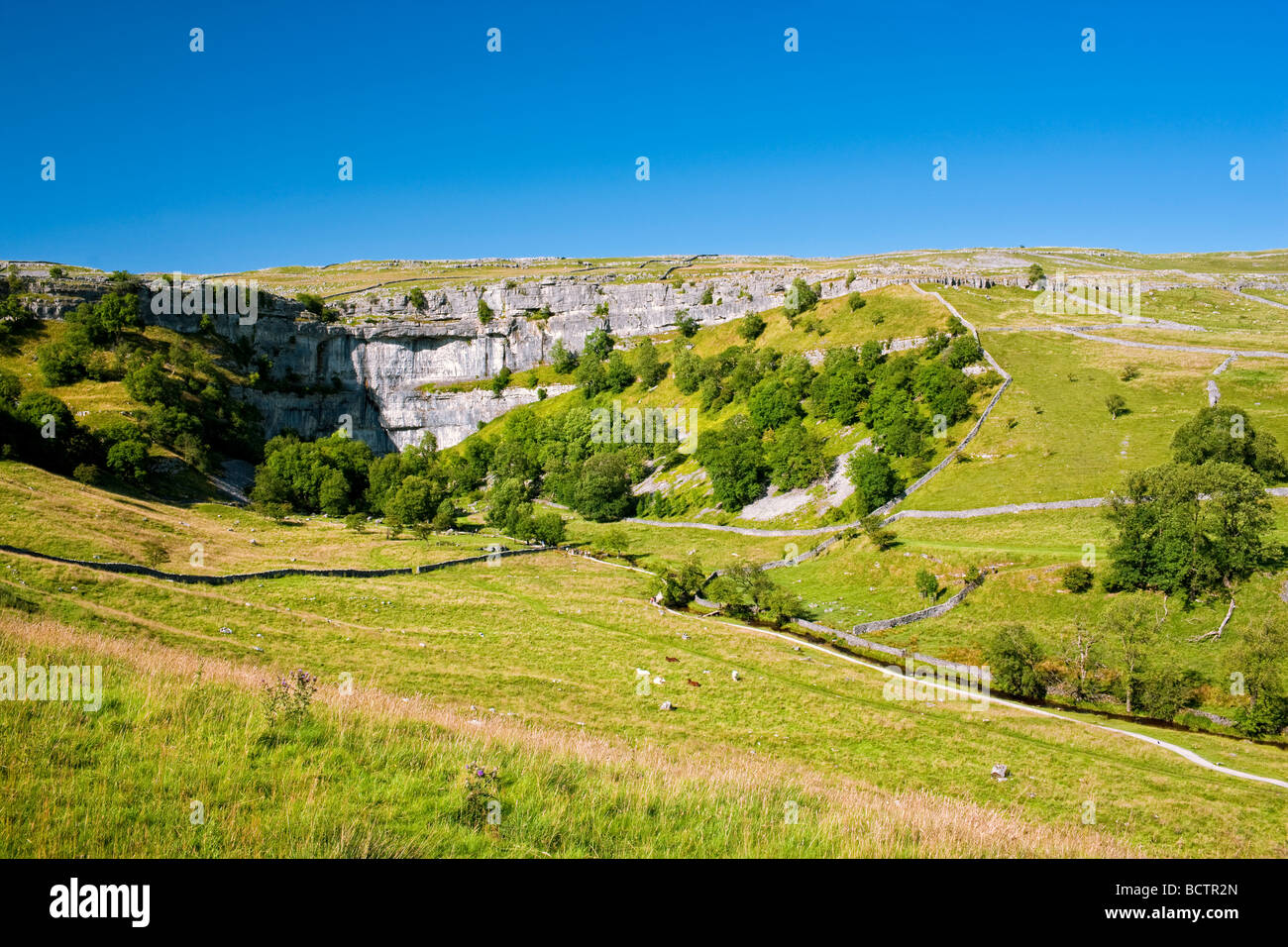 Malham Cove in the Yorkshire Dales on a sunny summer's evening - Stock Image