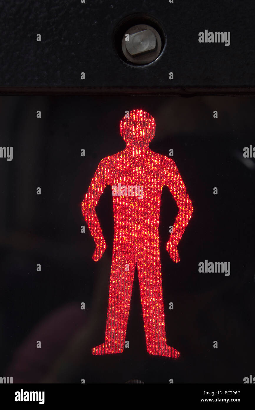 Britain UK Close up of illuminated red man stop and wait symbol on a pedestrian crossing - Stock Image