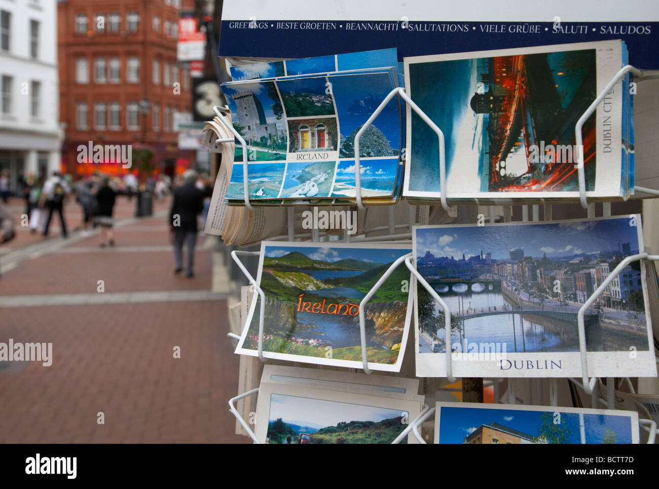 postcards of ireland outside a tourist shop on grafton street in dublin city centre republic of ireland - Stock Image
