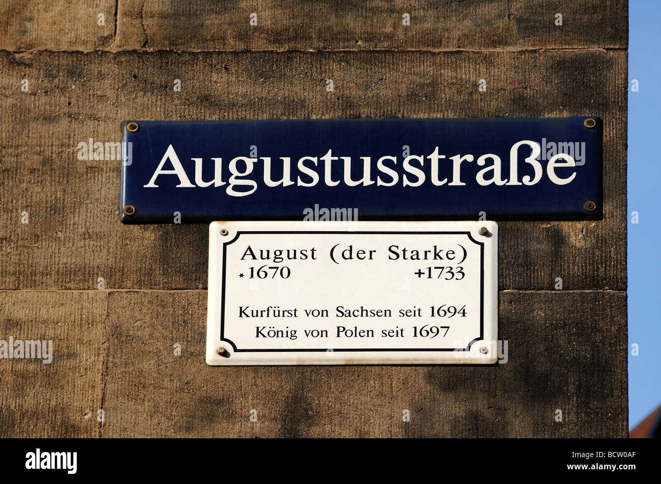 Street sign, Augustustrasse, with a plaque giving information about the street name, Dresden, Saxony, Germany, Europe - Stock Image