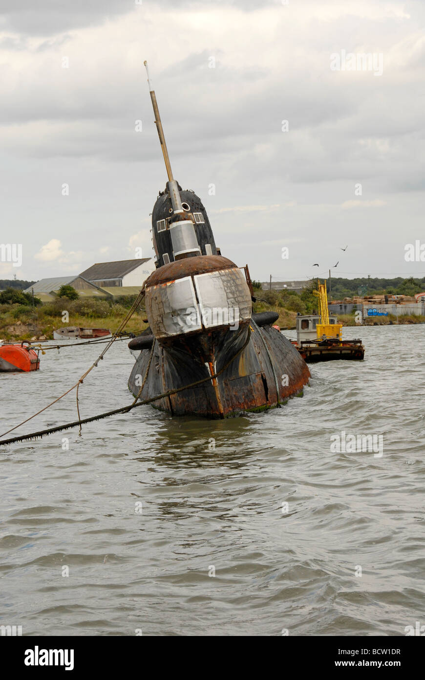 Derelict Russian submarine moored on river Medway, Rochester, Kent, England - Stock Image