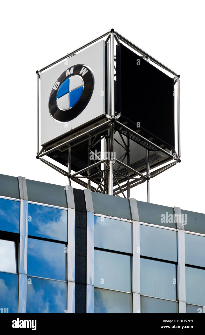 rotating BMW brand sign on roof of office building - Stock Image