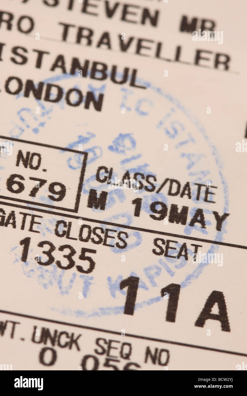 Airplane passenger flight boarding card ticket showing seat number - Stock Image