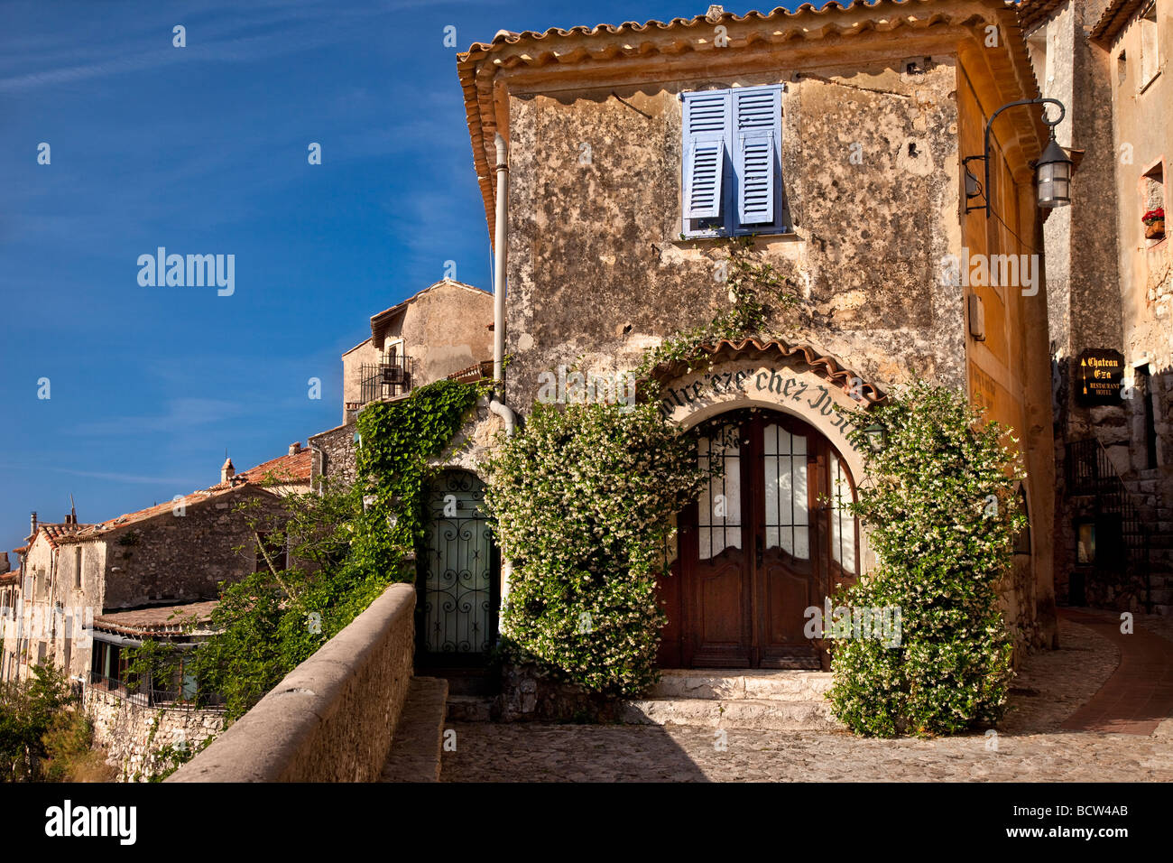 Jasmine flowers covering entryway to building in Eze, Provence France - Stock Image
