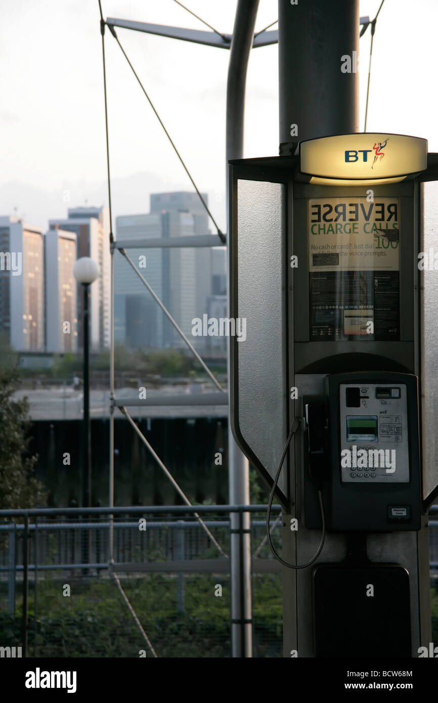 BT phone booth with Docklands in the background, London, UK - Stock Image