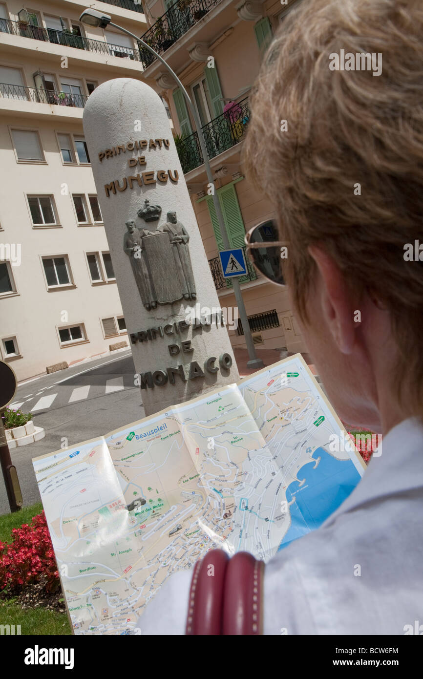 Map Of South Of France And Monaco.Woman Tourist With Map Principality Of Monaco South Of