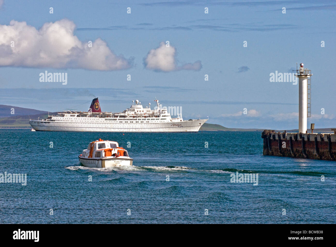 Cruise Liner Mona Lisa is visiting Kirkwall Harbour on a sunny June day with passengers being transported from and - Stock Image