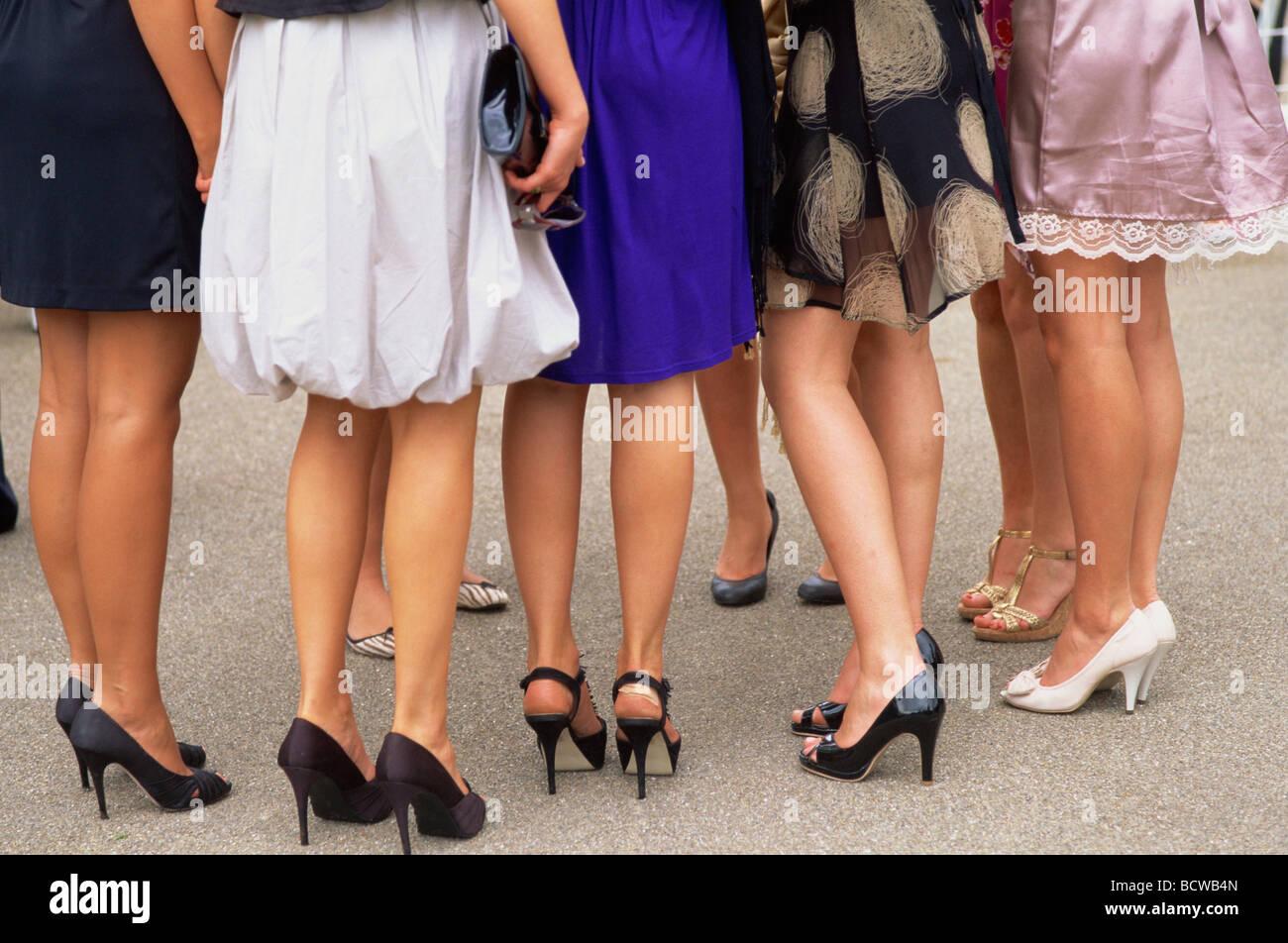 Legs of a group of women in a racecourse, Ascot Racecourse, Ascot, England - Stock Image