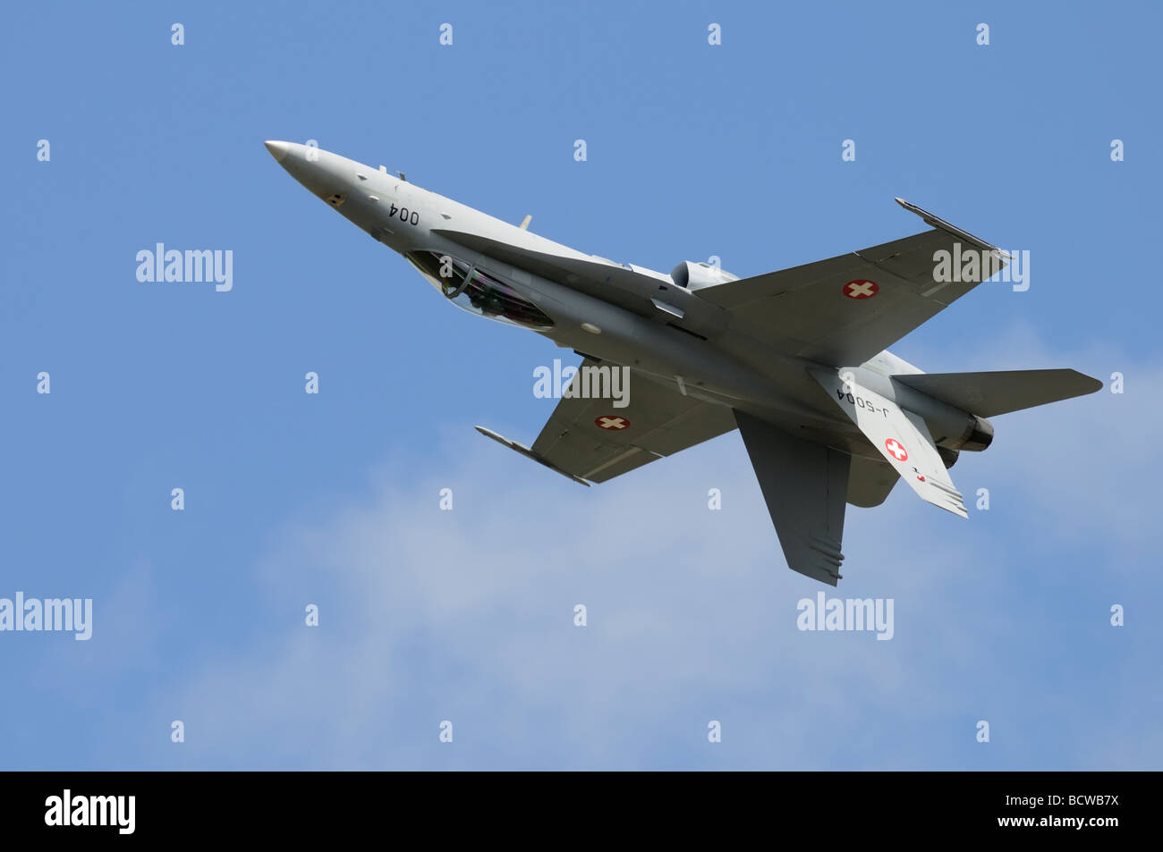 Swiss Air Force McDonnell Douglas F18 Hornet inverted during its display at the 2009 Royal International Air Tattoo - Stock Image