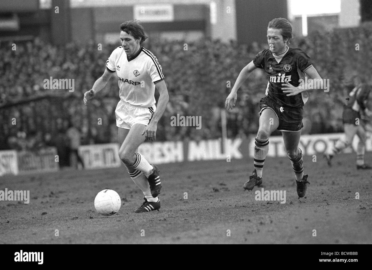 Aston Villa v Manchester United at Villa Park Uniteds Arnold Muhren and Villa s Alan Curbishley - Stock Image