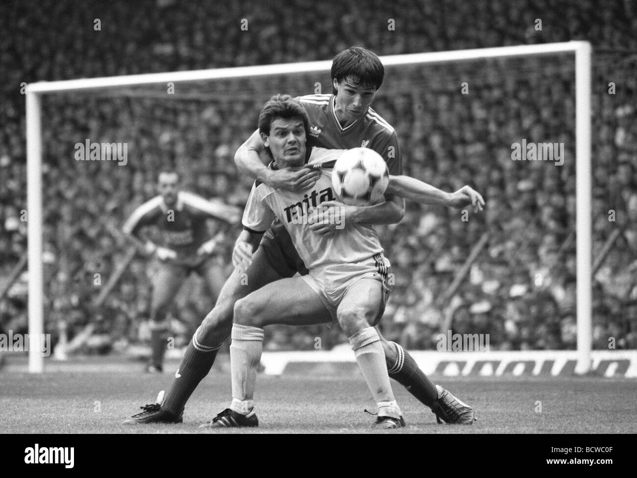 Liverpool V Aston Villa at Anfield 27 9 86 Alan Hansen fouls Steve Hodge to give away a penalty - Stock Image