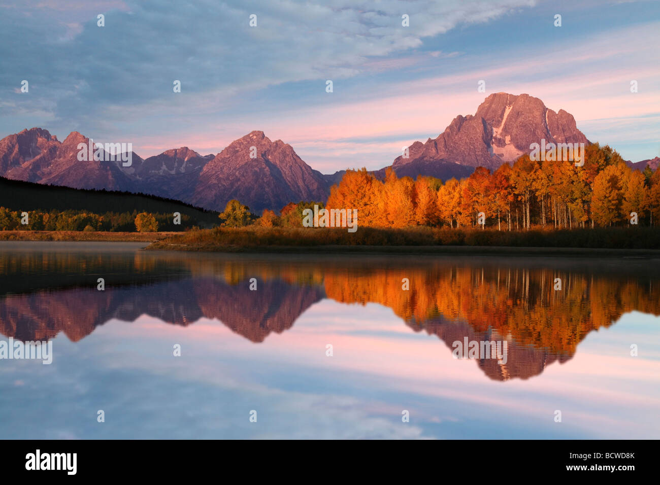Reflection of mountain and trees in a river, Oxbow Bend, Snake River, Grand Teton National Park, Wyoming, USA - Stock Image