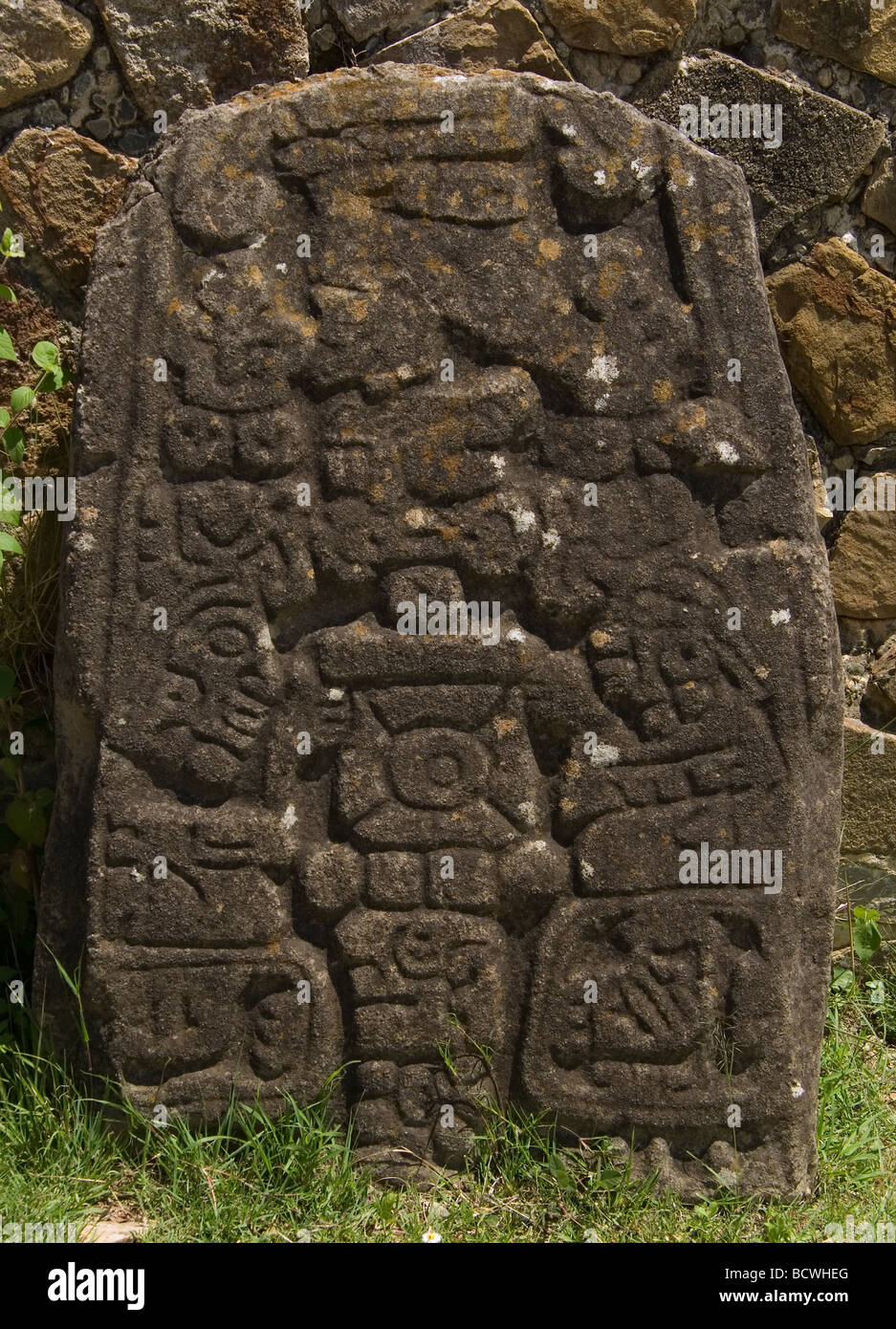 Glyphs carved 300 BC  defeated leaders neighboring villages Monte Alban Ruin Site Oaxaca, Mexico, 500 BC-750 AD - Stock Image