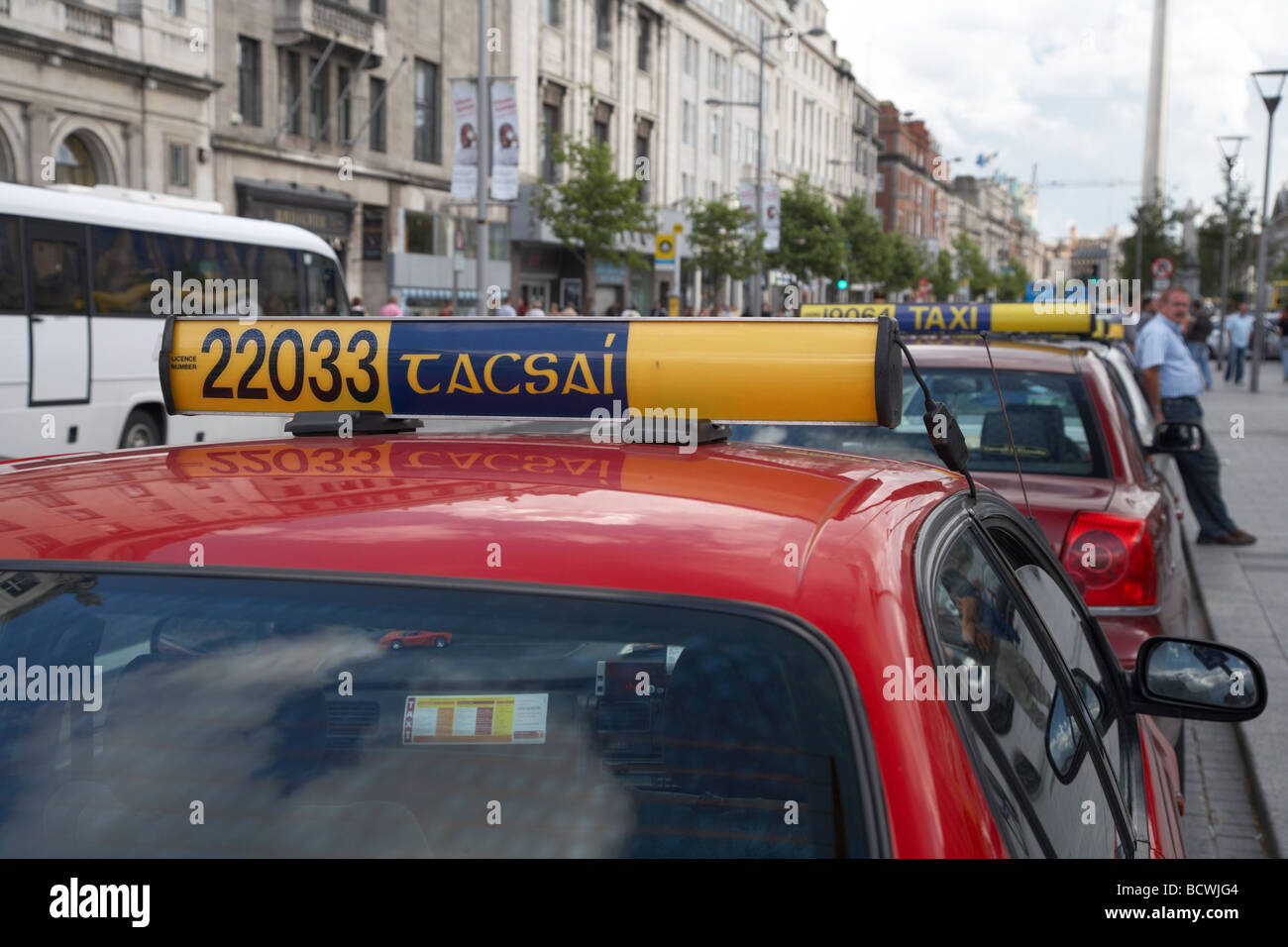 taxi with irish spelling tacsai on for hire board in a taxi rank in oconnell street dublin city centre republic Stock Photo