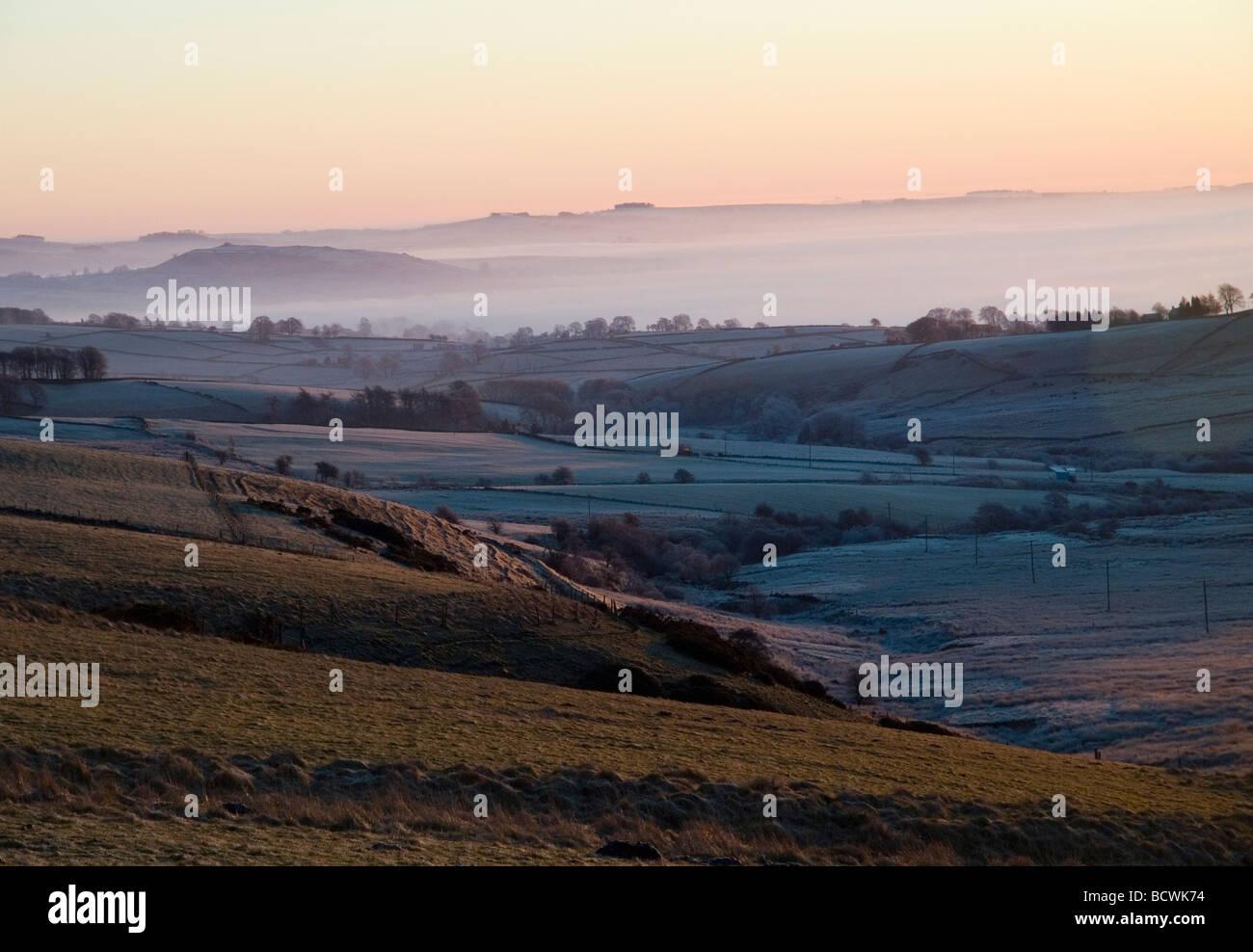 Sunrise over the frozen winter landscape near Longnor near Buxton in the Peak District, Derbyshire England UK - Stock Image