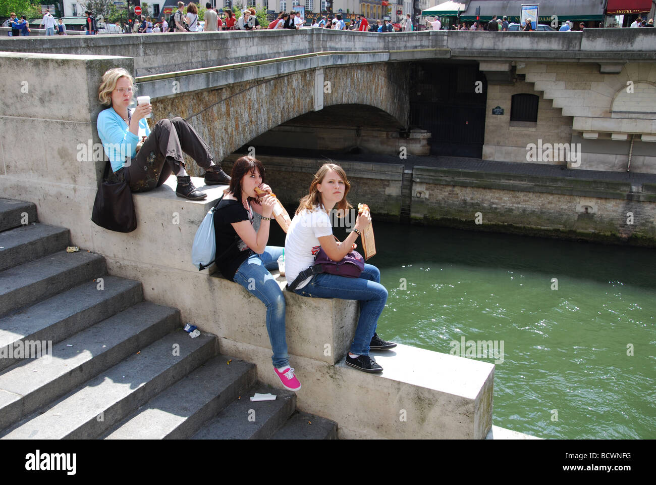 students relaxing near Notre Dame, Paris France - Stock Image
