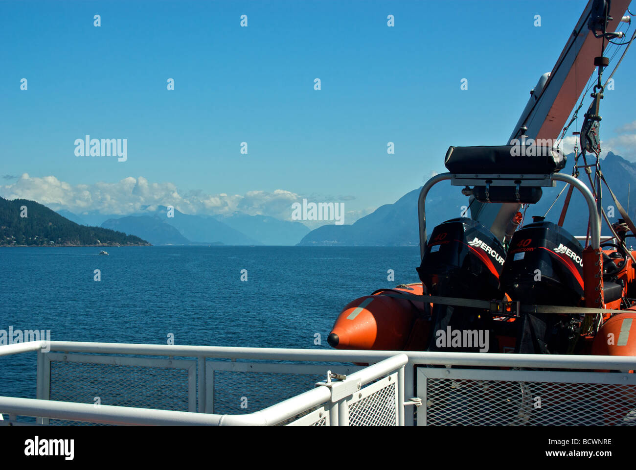 Twin outboard motor powered rigid hull inflatable rescue boat aboard BC Ferry - Stock Image
