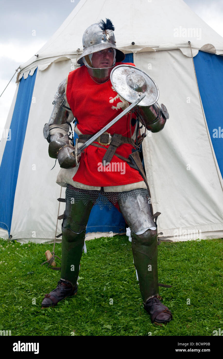 15th Century costumed armed historical figure. A knight wearing chain mail with sword at Preston Riverside Festival, - Stock Image