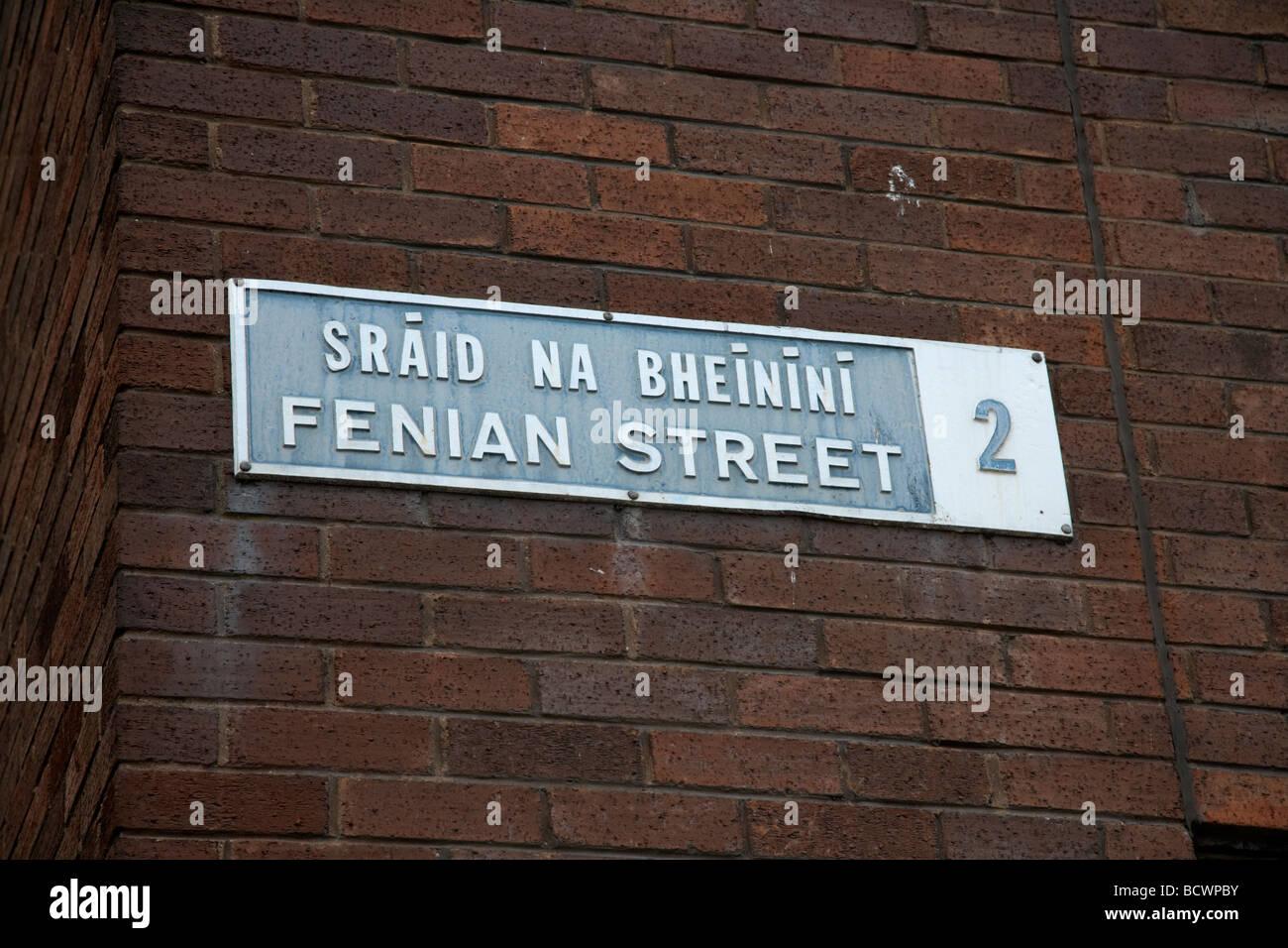 old bilingual street sign in english and irish for fenian street dublin 2 republic of ireland - Stock Image