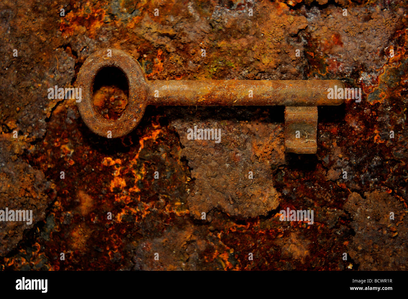 Rusty antique key on rusted iron plate & Rusty antique key on rusted iron plate Stock Photo: 25153123 - Alamy