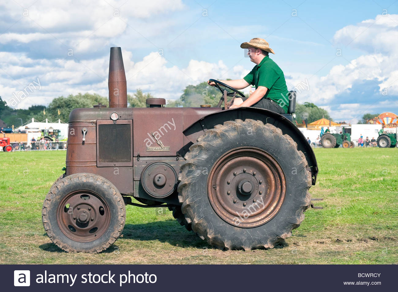 Vintage tractor at Welland Steam Rally, UK. 'Field Marshall' classic tractor. Parade in show ring. Rusty - Stock Image