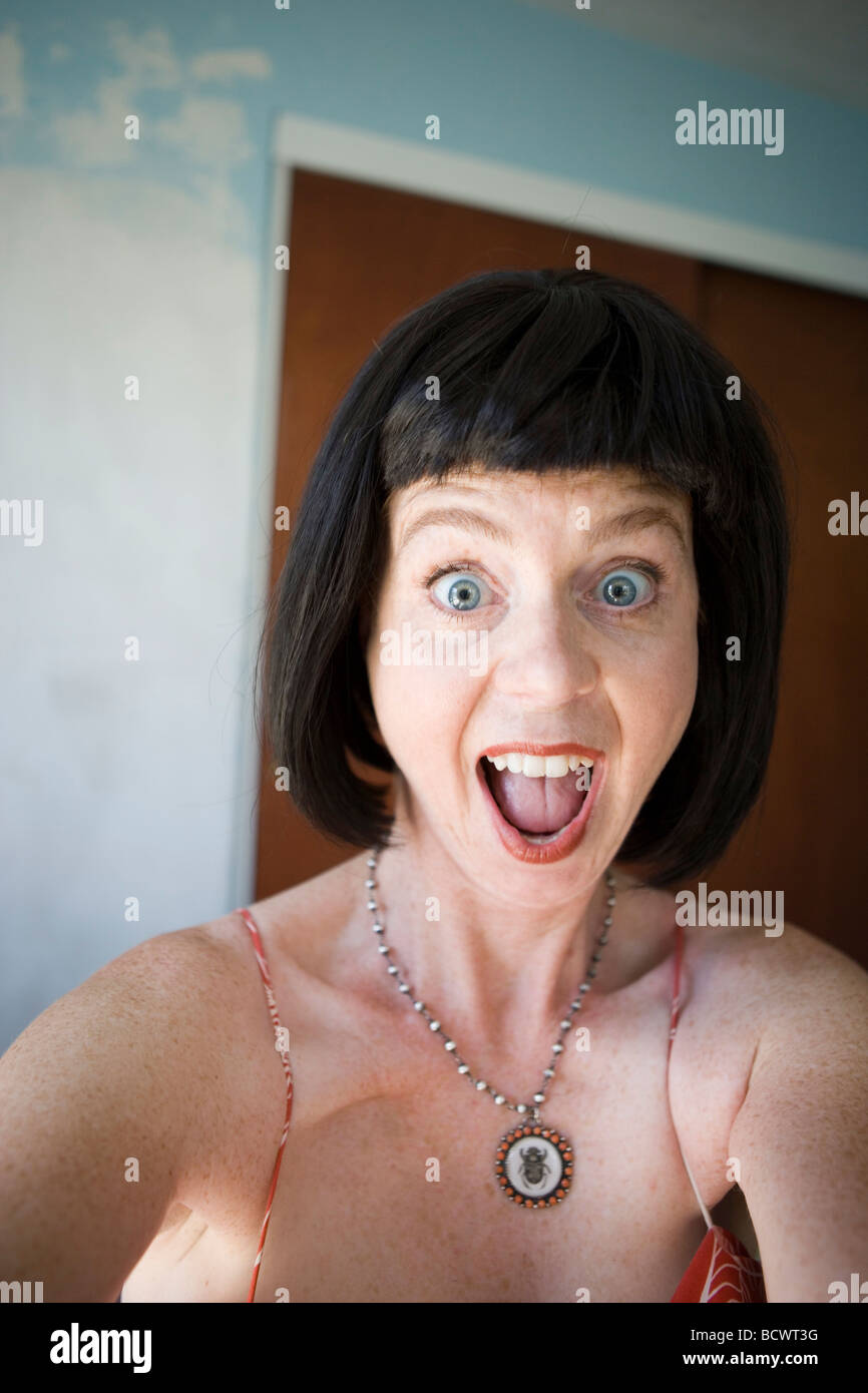 woman with an expression of shock and disbelief - Stock Image