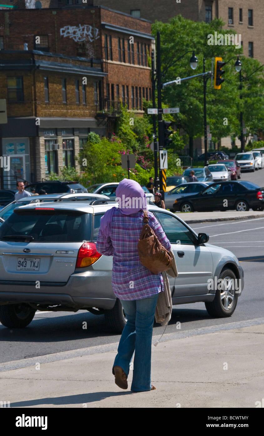 Muslim women walking downtown Montreal Canada - Stock Image