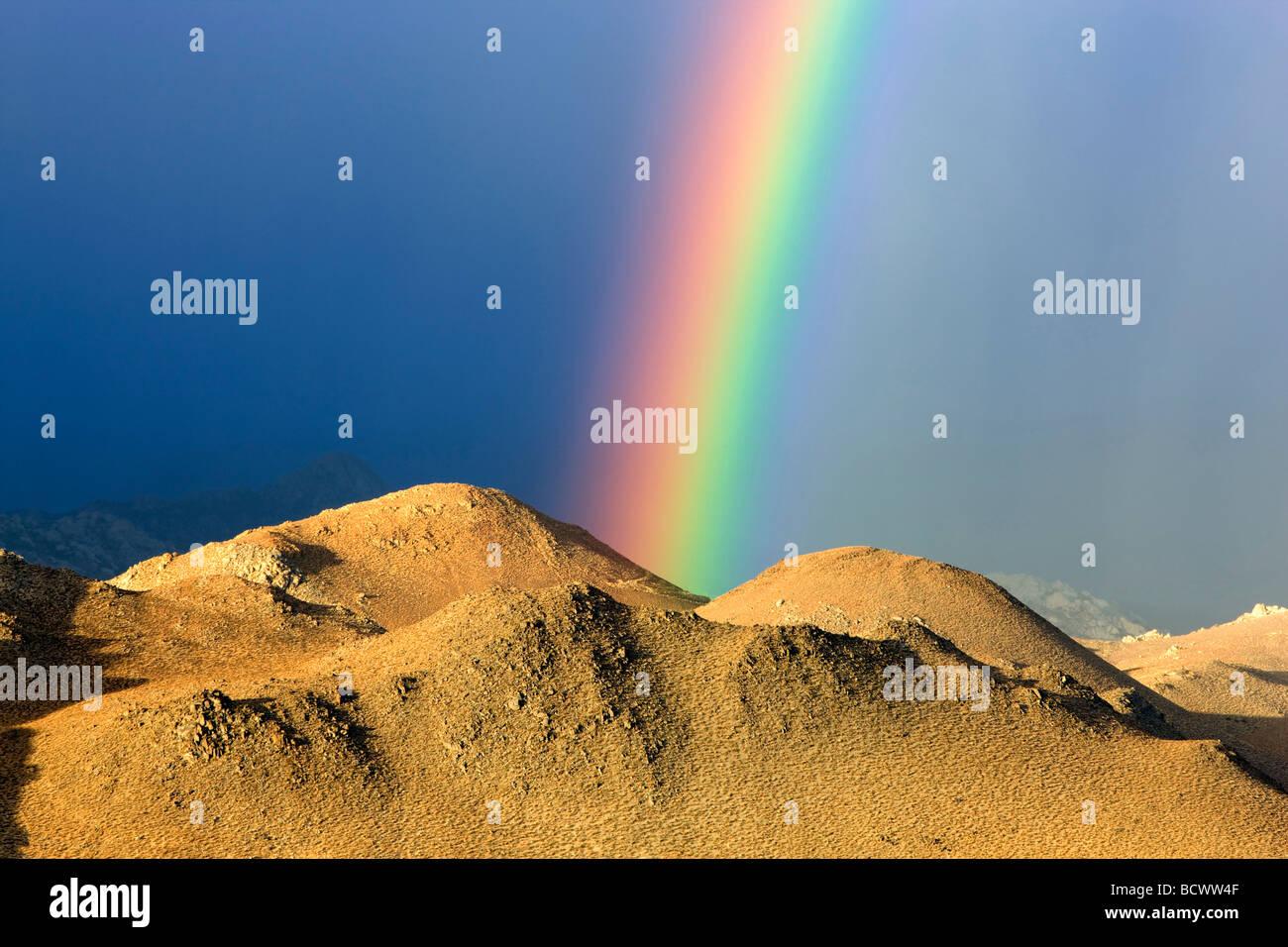 Rainbow over Eastern Sierra Mountains near Bishop California - Stock Image