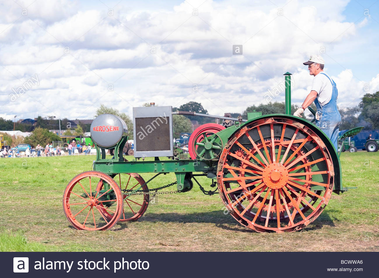 Vintage tractor at Welland Steam Rally, UK. misc classic tractor. Parade in show ring. - Stock Image