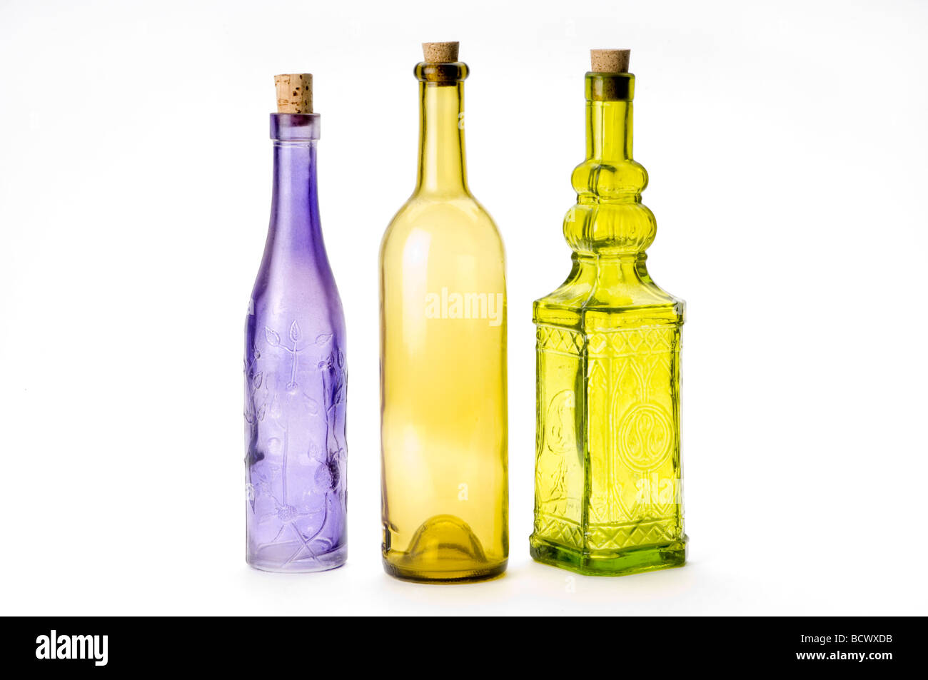 colorful glass bottles on white - Stock Image