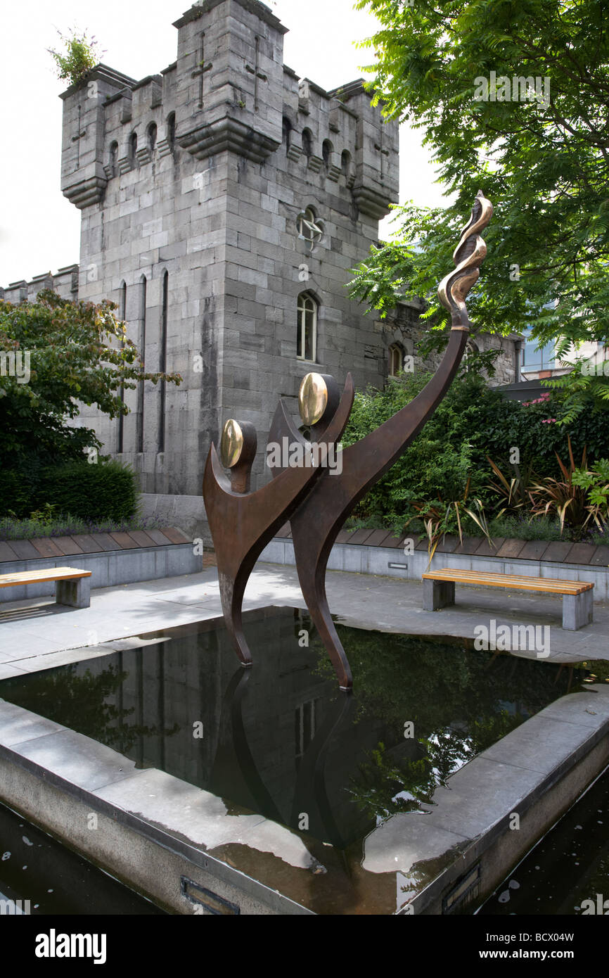 memorial to the 2003 special olympics in dubh linn gardens in the grounds of dublin castle with the coach house - Stock Image