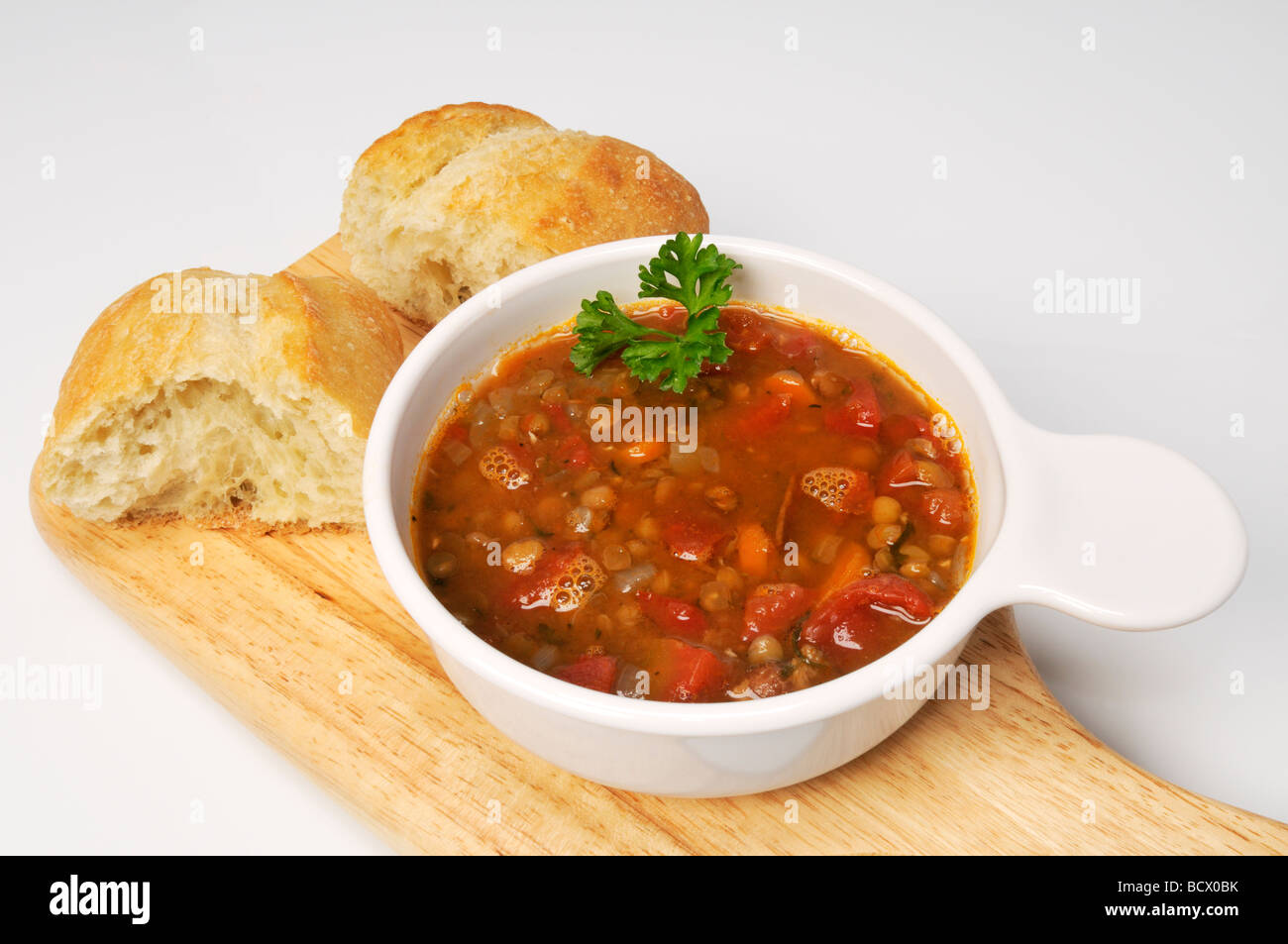 Bowl of lentil soup with roll Stock Photo