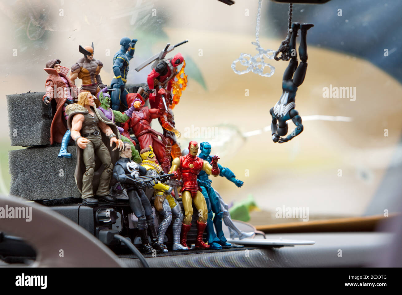 Comicbook figurines inside a storm chaser s car in Salina Kansas - Stock Image