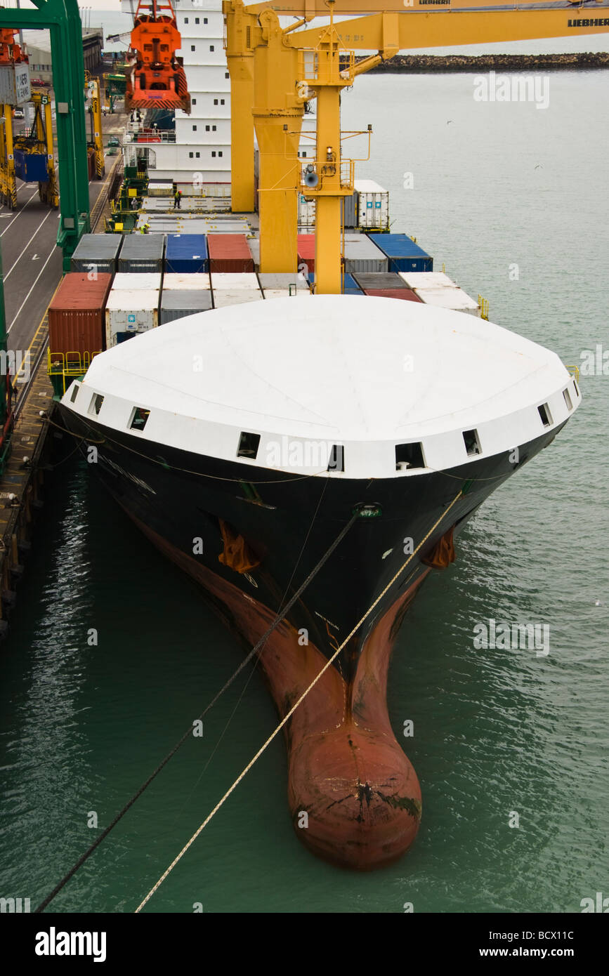 Bulbous bow and enclosed forecastle of a container ship - Stock Image