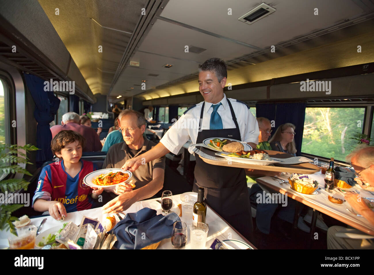 Aboard The California Zephyr Iowa A Waiter Serves Dinner In A Dining Stock Photo Alamy