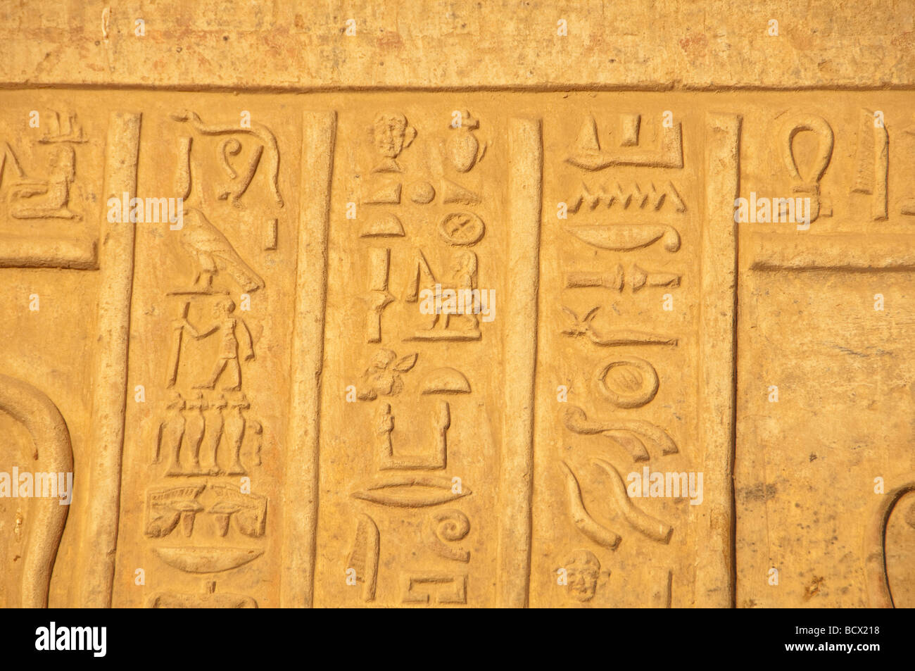 Egypt Kom Ombo temple wall of carvings reliefs hieroglyphs numerous symbols - Stock Image