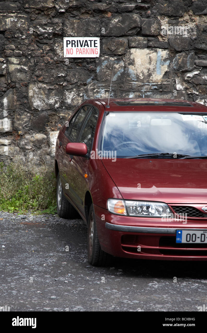 dublin registered irish car parked in front of private no parking sign dublin republic of ireland - Stock Image