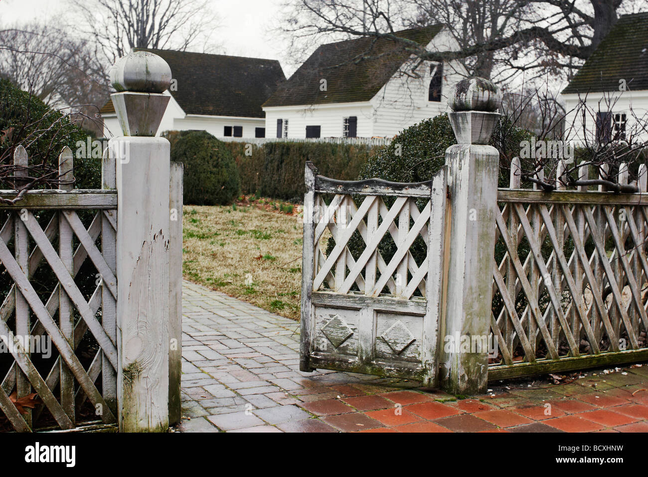 A Fence Gate And Brick Path In Colonial Williamsburg