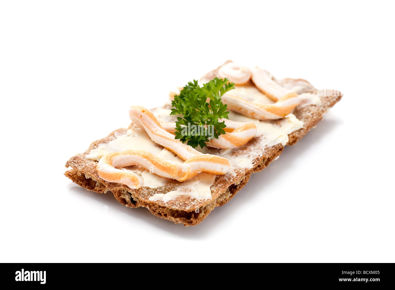 Swedish rye bread with butter caviar and parsley Shallow d o f - Stock Image