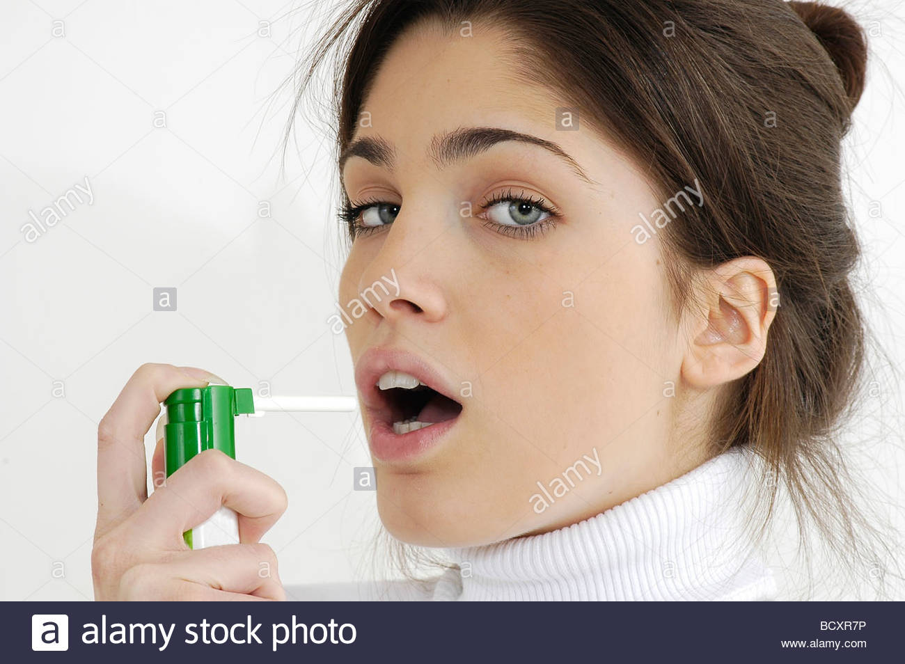 young woman, sore throat, atomizer - Stock Image